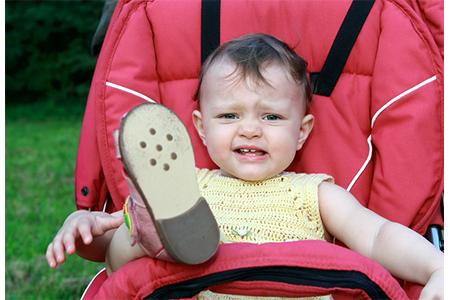 child-won't-keep-shoes-on